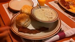 my daughters biscuits and gravy normally comes with two eggs but my daughter wanted bacon instea