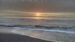 Sunset at beach below
