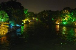 View on lake and park at night time