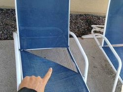 Ripped-out pool chair not fixed or removed in the week I stayed here