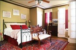 Garnet Room with whirlpool tub, steam shower, gas log fireplace and balcony