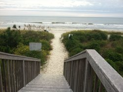 The view as you step out onto the beach from the Monarch Resort