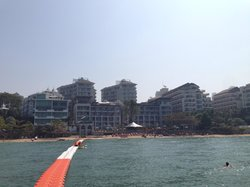 View of the hotel & beach from the floating walkway.