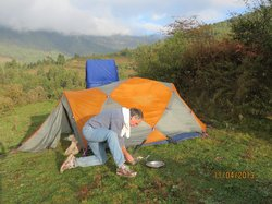 Preparing for the day after a good sleep (toilet tent in background)