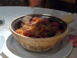 Mixing various meat & rice in the clay-pot