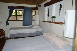 A full size and a twin size bed in the Tiki Bungalow