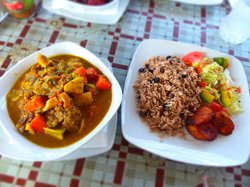 """Standard side dish of red beans and rice (also known as """"peas and rice"""") as well as fried planta"""