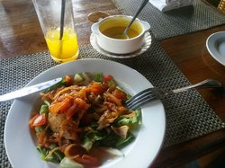 Having lunch with orange juice . was very cool place and so english . the staff friendly, music