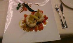 Filetto di branzino con punte di asparagi e pomodorini