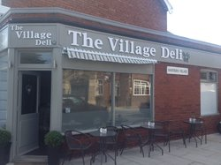 ‪The Village Deli‬