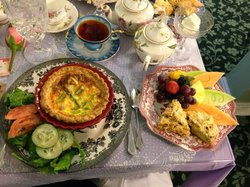"""Quiche, the """"Cream Tea"""" with fruit and scones and a personal pot of tea."""