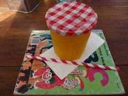 Fresh oj is in twist top jar served on a little golden book.
