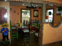 Authentic Mexican tile and walls in semi private dining area.