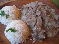 Beef tongue cooked in mushroom cream herb sauce