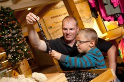 Playing with magnetic stones in the Rushmore Cave gift shop.