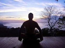 buddha on the deck at sunrize