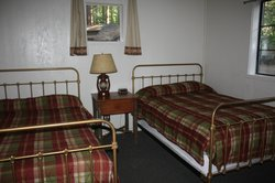 Cabin w/o bath. Clean & comfy no-frills cabin. Room for air mattress on floor, if needed. Fan in