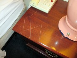 swastika scratched in night stand