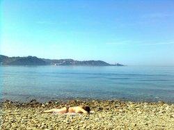 wild, nude beach (in the distance Piran)