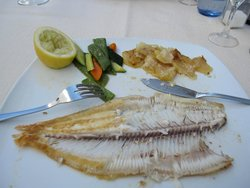 Half eaten dover sole - very well cooked