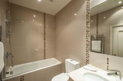 Stylish modern bathrooms come with weekly towel change.