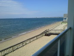 View of beach from veranda outside second floor.