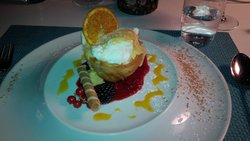 One of the desserts: cooked egg white with cocoanut, red fruits' coulis, milk jam and a pastry!