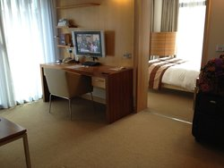 View from the loung area of room into bedroom