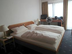 Room: Bed, table and fan