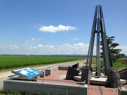 The monument of latitude-longitude confluens