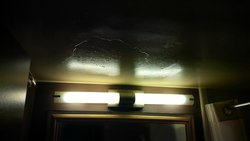 The ceiling in front of the mirror after a show ran....dripping yellow water