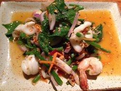 Seafood salad with nasturtum leaves