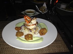Lobster tail on a bed of cabbage rice, Wasabi aoli & deep fried avocado