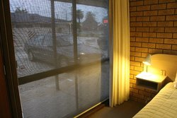 View to carpark through privacy screens and bedside light