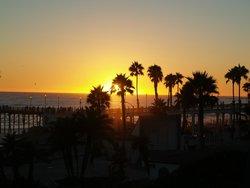 sunset near the pier that is a block away
