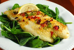 Grilled Bass over Baby Spinach