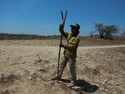 Our guide Agus with his forked stick to ward off errant Komodo Dragons