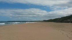 The deserted beach outside Ramada gates looking toward Blackhead