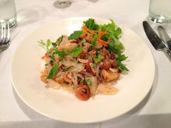 Spicy Pomelo Salad with Crispy Shallot, Roasted Coconut and Peanuts served with Deep-Fried Dory