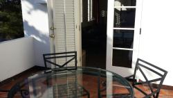 Room 215 corner room, second floor, with beautiful outside terrace, with a table, four chairs, u