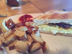 Mediocre breakfast sandwich. Bacon egg and cheese on brioche. The sandwich was very dry... Could