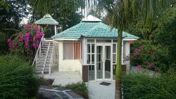 glass cottage with gazebo