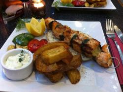 Salmon Souvlaki with chargrilled vegetables,home made chunky chips,tzaziki and pita bread