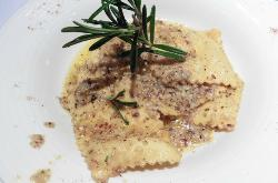 Homemade ravioli filled with truffles and ricotta, haselnut butter