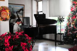 Resident pianist plays here every morning while guests are having breakfast
