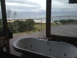Amazing view from the jacuzzi bath with sliding doors open