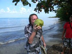 Mark drinking a fresh cut coconut that Witi got down for us!
