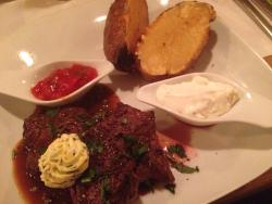 Really nice steak with potato and sour cream