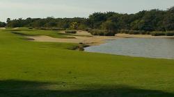 A golf hole with a croc