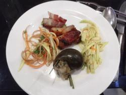 Snail, jellyfish with banana flower salad, green beans wrapped in bacon and mango salad